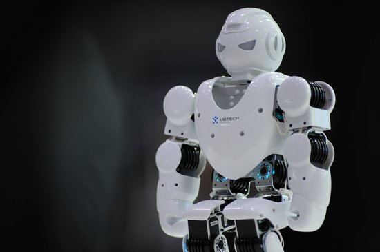 TOKYO, JAPAN - DECEMBER 03: A small humanoid robot is seen during the international Robot exhibition 2015 at Tokyo Big Sight, Japan, on December 3, 2015. (Photo by David MAREUIL/Anadolu Agency/Getty Images)