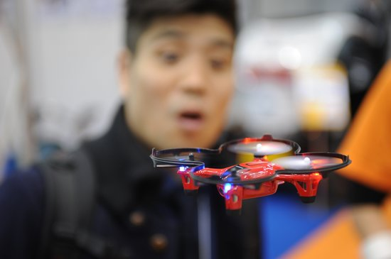TOKYO, JAPAN - DECEMBER 03: A miniature drone is seen during the international Robot exhibition 2015 at Tokyo Big Sight, Japan, on December 3, 2015. (Photo by David MAREUIL/Anadolu Agency/Getty Images)