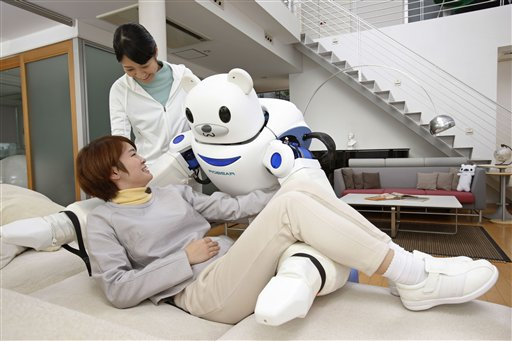 Robear helping a patient Robear nursing care robot, Japan - 02 Mar 2015 FULL COPY: http://www.rexfeatures.com/nanolink/q1vj Scientists from RIKEN and Sumitomo Riko Company Limited have developed a new experimental nursing care robot, ROBEAR, which is capable of performing tasks such as lifting a patient from a bed into a wheelchair or providing assistance to a patient who is able to stand up but requires help to do so. ROBEAR will provide impetus for research on the creation of robots that can supplement Japan?s need for new approaches to care-giving. The new robot developed by the RIKEN-SRK Collaboration Center for Human-Interactive Robot Research in Nagoya is a successor to RIBA, which was announced in 2009, and RIBA-II, which was developed in 2011. The new ROBEAR robot is lighter than its predecessors, weighing just 140 kilograms compared to RIBA-II?s 230 kilograms, and it incorporates a number of features that enable it to exert force in a gentle way. (Rex Features via AP Images)
